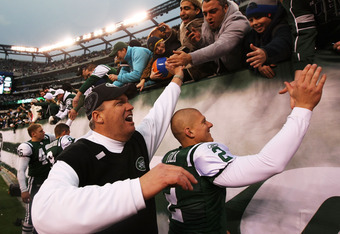 EAST RUTHERFORD, NJ - JANUARY 02:  Head coach Rex Ryan and Nick Folk #2 of the New York Jets celebrate with fans after they defeated the Buffalo Bills 38 to 7 at New Meadowlands Stadium on January 2, 2011 in East Rutherford, New Jersey.  (Photo by Al Bell