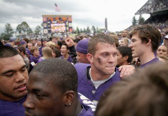 SEATTLE - SEPTEMBER 19:  Quarteback Jake Locker #10 of the Washington Huskies celebrates the win against the USC Trojans on September 19, 2009 at Husky Stadium in Seattle, Washington. The Huskies defeated the Trojans 16-13. (Photo by Otto Greule Jr/Getty