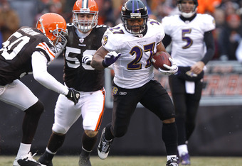 CLEVELAND - DECEMBER 26:  Running back Ray Rice #27 of the Baltimore Ravens runs by linebackers Eric Barton #50 and Matt Roth #53 of the Cleveland Browns at Cleveland Browns Stadium on December 26, 2010 in Cleveland, Ohio.  (Photo by Matt Sullivan/Getty I