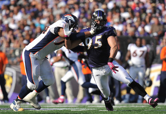 BALTIMORE, MD - OCTOBER 10: Jarret Johnson #95 of the Baltimore Ravens defends during the game against the Denver Broncos at M&T Bank Stadium on October 10, 2010 in Baltimore, Maryland. Players wore pink in recognition of Breast Cancer Awareness Month. Th