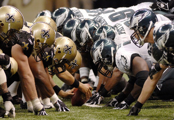 The New Orleans offensive line against the Philadelphia Eagles defense on Oct. 15, 2006 in New Orleans.  The Saints defeated the Eagles on a last-minute field goal.  (Photo by Al Messerschmidt/Getty Images)