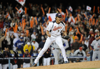 LOS ANGELES - MARCH 22: Pitcher Yu Darvish #11 of Japan celebrates after striking out Adam Dunn #17 of the United States to win the semifinal game of the 2009 World Baseball Classic on March 22, 2009 at Dodger Stadium in Los Angeles, California. Japan def