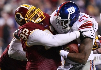 Albert Haynesworth (92) takes down Brandon Jacobs of the New York Giants