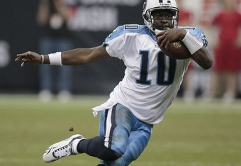 HOUSTON - NOVEMBER 23:  Quarterback Vince Young #10 of the Tennessee Titans scrambles for a first down in the fourth quarter against the Houston Texans at Reliant Stadium on November 23, 2009 in Houston, Texas. Tennessee won 20-17 on a Rob Bironas 53 yard