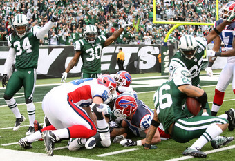 EAST RUTHERFORD, NJ - JANUARY 02:  Dwight Lowery #26 of the New York Jets recovers a fumble by the Buffalo Bills at New Meadowlands Stadium on January 2, 2011 in East Rutherford, New Jersey.  (Photo by Michael Heiman/Getty Images)