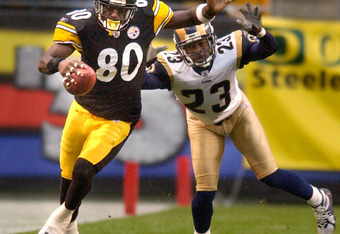 PITTSBURGH - OCTOBER 26:  Wide receiver Plaxico Burress #80 of the Pittsburgh Steelers is chased out of bounds by cornerback Jerametrius Butler #23 of the St. Louis Rams during the second quarter on October 26, 2003 at Heinz Field in Pittsburgh, Pennsylva