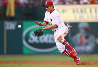 ST. LOUIS, MO - JULY 28: Ryan Theriot #3 of the St. Louis Cardinals fields a one hopper against the Houston Astros at Busch Stadium on July 28, 2011 in St. Louis, Missouri.  The Astros beat the Cardinals 5-3.  (Photo by Dilip Vishwanat/Getty Images)