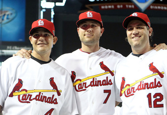 PHOENIX, AZ - JULY 12: National League All-Star Yadier Molina #4 of the St. Louis Cardinals, National League All-Star Matt Holliday #7 of the St. Louis Cardinals and National League All-Star Lance Berkman #12 of the St. Louis Cardinals pose during batting