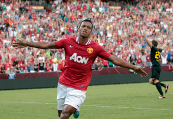 Nani of Manchester United celebrates after scoring the first goal of the match. Nani put the ball through the legs of FC Barcelona goalie Victor Valdés in the 20th minute.