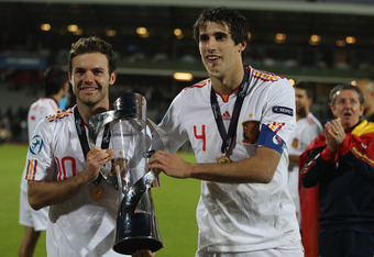 ARHUS, DENMARK - JUNE 25:  Juan Mata (L) and Javi Martinez (R) pose with the winners trophy after their 2-0 victory during the UEFA European Under-21 Championship Final match between Spain and Switzerland at the Arhus Stadium on June 25, 2011 in Arhus, De