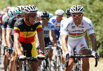 LES HERBIERS, FRANCE - JULY 02:  Stage winner Philippe Gilbert of Belgium (l) and Omega Pharma-Lotto chats to World Road Race Champion Thor Hushovd of Norway and Garmin-Cervelo during stage one of the 2011 Tour de France from Passage du Gois to Mont des A