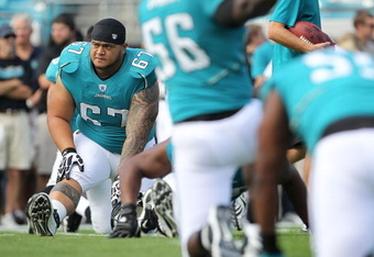 JACKSONVILLE, FL - NOVEMBER 21:  Vince Manuwai #67 of the Jacksonville Jaguars stretches  during a game agaisnt the Cleveland Browns at EverBank Field on November 21, 2010 in Jacksonville, Florida.  (Photo by Mike Ehrmann/Getty Images)