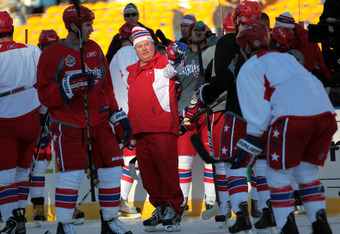 PITTSBURGH, PA - DECEMBER 31:  Head coach Bruce Boudreau of the Washington Capitals instructs players during practice for the 2011 NHL Winter Classic between the Capitals and the Pittsburgh Penguins on December 31, 2010 at Heinz Field in Pittsburgh, Penns
