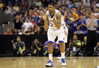 SAN ANTONIO, TX - MARCH 27:  Marcus Morris #22 of the Kansas Jayhawks reacts during the southwest regional final of the 2011 NCAA men's basketball tournament against the Virginia Commonwealth Rams at the Alamodome on March 27, 2011 in San Antonio, Texas.