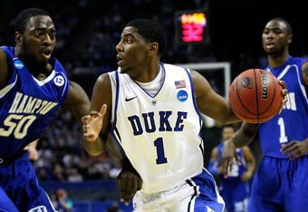 CHARLOTTE, NC - MARCH 18:  Kyrie Irving #1 of the Duke Blue Devils drives on Milade Lola-Charles #50 of the Hampton Pirates in the first half during the second round of the 2011 NCAA men's basketball tournament at Time Warner Cable Arena on March 18, 2011