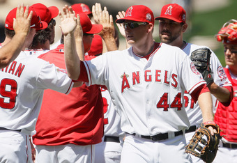 ANAHEIM, CA - JULY 21:  Mark Trumbo #44 of the Los Angeles Angels of Anaheim celebrates following his teams victory over the Texas Rangers at Angel Stadium of Anaheim on July 21, 2011 in Anaheim, California. The Angels defeated the Rangers 1-0.  (Photo by