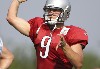 ALLEN PARK, MI - AUGUST 01: Matthew Stafford #9 of the Detroit Lions drops back to pass during the morning practice session at the Lions training facility on August 1, 2011 in Allen Park, Michigan.  (Photo by Leon Halip/Getty Images)