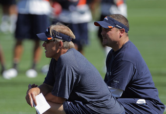 ENGLEWOOD, CO - JULY 28:  (L-R) John Elway, Executive Vice President of Football Operations and Brian Xanders, General Manager of the Denver Broncos watch from the sideline during training camp at the Paul D. Bowlen Memorial Broncos Centre at Dove Valley