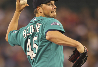 SEATTLE - JUNE 27:  Starting pitcher Erik Bedard #45 of the Seattle Mariners pitches against the Atlanta Braves at Safeco Field on June 27, 2011 in Seattle, Washington. (Photo by Otto Greule Jr/Getty Images)