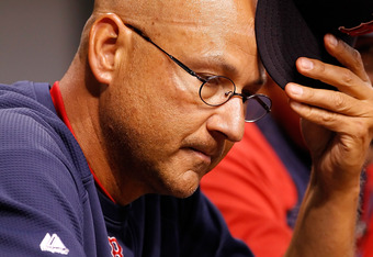 ST. PETERSBURG, FL - JULY 15:  Manager Terry Francona #47 of the Boston Red Sox scratches his head during the game against the Tampa Bay Rays at Tropicana Field on July 15, 2011 in St. Petersburg, Florida.  (Photo by J. Meric/Getty Images)
