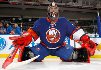 UNIONDALE, NY - JULY 16: Chris Rawling #52 of the New York Islanders streches prior to the start of the skills competition on July 16, 2011 at Nassau Coliseum in Uniondale, New York. (Photo by Mike Stobe/Getty Images)