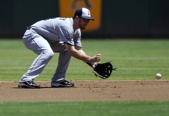 OAKLAND, CA - JULY 4:  Dustin Ackley #13 of the Seattle Mariners fields a ground ball against the Oakland Athletics at Oakland-Alameda County Coliseum on July 4, 2011 in Oakland, California. (Photo by Chad Ziemendorf/Getty Images)