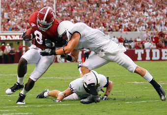 TUSCALOOSA, AL - SEPTEMBER 11:  Julio Jones #8 of the Alabama Crimson Tide is tackled by Nick Sukay #1 of the Penn State Nittany Lions at Bryant-Denny Stadium on September 11, 2010 in Tuscaloosa, Alabama.  (Photo by Kevin C. Cox/Getty Images)