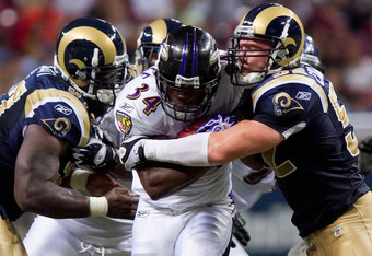 ST. LOUIS - SEPTEMBER 2: Bobby Carpenter #52 of the St. Louis Rams tackles Jalen Parmele #34 of the Baltimore Ravens during an NFL preseason game at the Edward Jones Dome on September 2, 2010 in St. Louis, Missouri.  (Photo by Dilip Vishwanat/Getty Images