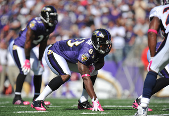 BALTIMORE, MD - OCTOBER 10: Ed Dickson #83 of the Baltimore Ravens defends against the Denver Broncos at M&T Bank Stadium on October 10, 2010 in Baltimore, Maryland. Players wore pink in recognition of Breast Cancer Awareness Month. The Ravens defeated th