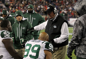 FOXBORO, MA - DECEMBER 06:  Head coach Rex Ryan of the New York Jets talks to his players on the bench during the first quarter against the New England Patriots at Gillette Stadium on December 6, 2010 in Foxboro, Massachusetts.  (Photo by Chris Chambers/G