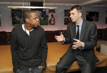 NEW YORK - MAY 18:  (EXCLUSIVE) Cultural icon and Nets investor JAY-Z and Nets owner Mikhail Prokhorov celebrate Prokhorov's purchase of the team at lunch today at JAY-Z's 40/40 club on May 18, 2010 in New York City. Prokhorov is representing the Nets ton