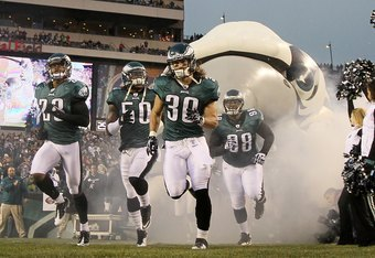 PHILADELPHIA, PA - JANUARY 02:  Dimitri Patterson #23, Sean Lee #50, Colt Anderson #30, and Mike Patterson #98 of the Philadelphia Eagles take the field to play against the Dallas Cowboys on January 2, 2011 at Lincoln Financial Field in Philadelphia, Penn