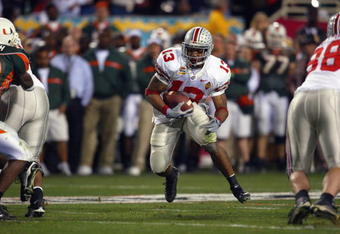 TEMPE, AZ - JANUARY 3:  Running back Maurice Clarett #13 of the Ohio State Buckeyes finds a hole against the University of Miami Hurricanes during the Tostitos Fiesta Bowl at Sun Devil Stadium on January 3, 2003 in Tempe, Arizona.  Ohio State won the game