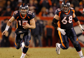 DENVER, CO - JANUARY 2:  Quarterback Tim Tebow #15 of the Denver Broncos runs for a first down past linebacker Antwan Applewhite #90 of the San Diego Chargers as guard Zane Beadles #68 trails the play during the fourth quarter at INVESCO Field at Mile Hig