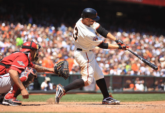 SAN FRANCISCO, CA - AUGUST 03:  Cody Ross #13 of the San Francisco Giants hits a two run double in the fifth inning against the Arizona Diamondbacks at AT&T Park on August 3, 2011 in San Francisco, California.  (Photo by Jed Jacobsohn/Getty Images)