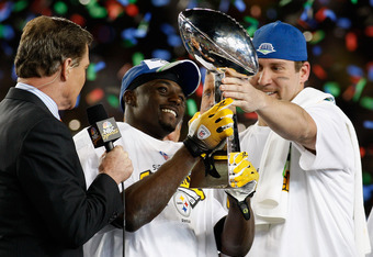 TAMPA, FL - FEBRUARY 01:  Ben Roethlisberger #7 hand Santonio Holmes #10 of the Pittsburgh Steelers the trophy after the Steelers won 27-23 against the Arizona Cardinals during Super Bowl XLIII on February 1, 2009 at Raymond James Stadium in Tampa, Florid