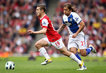 LONDON, ENGLAND - APRIL 02:  Michel Salgado of Blackburn pursues Jack Wilshere of Arsenal during the Barclays Premier League match between Arsenal and Blackburn Rovers at the Emirates Stadium on April 2, 2011 in London, England.  (Photo by Julian Finney/G