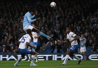 MANCHESTER, ENGLAND - OCTOBER 21:  Emmanuel Adebayor of Manchester City scores his second goal with a header during the UEFA Europa League Group A match between Manchester City and KKS Lech Poznan at City of Manchester Stadium on October 21, 2010 in Manch