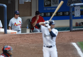 Aug. 3, 2011: LaRussa and Mark McGwire watch from the dugout in Milwaukee.  Braun stands bravely in the batter's box.