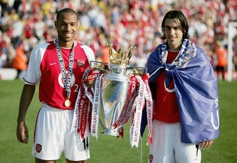 LONDON - MAY 15:  Thierry Henry and Robert Pires of Arsenal hold the Premiership trophy during the celebrations as they celebrate winning the Premiership during the FA Barclaycard Premiership match between Arsenal and Leicester City at Highbury on May 15,