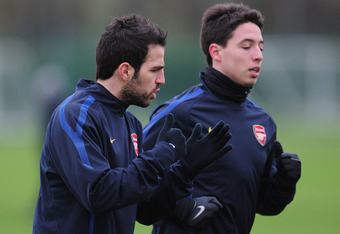 ST ALBANS, ENGLAND - FEBRUARY 15:  Cesc Fabregas and Samir Nasri of Arsenal warm-up during training at London Colney on February 15, 2011 in St Albans, England.  (Photo by Shaun Botterill/Getty Images)