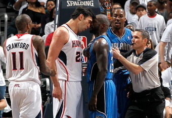 Notice Pachulia's massive gashes on his shoulder