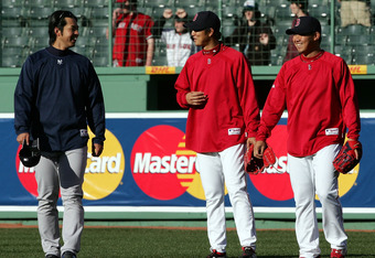 BOSTON - APRIL 20:  Hideki Okajima #37 and Daisuke Matsuzaka #18 of the Boston Red Sox talk with Kei Igawa #29 of the New York Yankees on April 20, 2007 at Fenway Park in Boston, Massachusetts.  (Photo by Elsa/Getty Images)