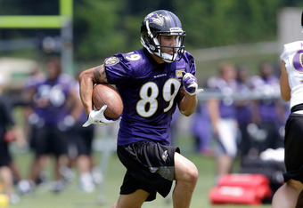 OWINGS MILLS, MD - JULY 29:  Tandon Doss #89 of the Baltimore Ravens works out during training camp on July 29, 2011 in Owings Mills, Maryland.  (Photo by Rob Carr/Getty Images)