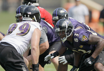 OWINGS MILLS, MD - JULY 29: Tight end Ed Dickson #83 of the Baltimore Ravens works out during training camp on July 29, 2011 in Owings Mills, Maryland.  (Photo by Rob Carr/Getty Images)