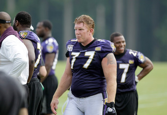 OWINGS MILLS, MD - JULY 29: Matt Birk #77 of the Baltimore Ravens works out during training camp on July 29, 2011 in Owings Mills, Maryland.  (Photo by Rob Carr/Getty Images)