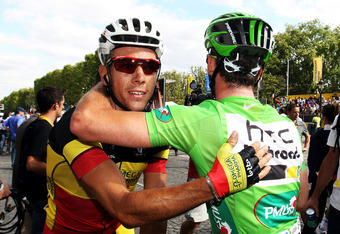 PARIS, FRANCE - JULY 24:  Philipe Gilbert (L) of team Omega Pharm Lotto congratulates Mark Cavendish of team HTC after he wins the final sprint during the twenty first and final stage of Le Tour de France 2011, from Creteil to the Champs-Elysees in Paris