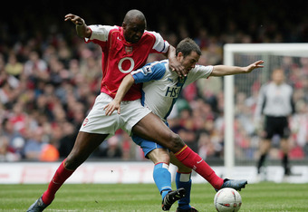 CARDIFF, UNITED KINGDOM - APRIL 16:  Patrick Vieira of Arsenal battles with David Thompson of Blackburn during the FA Cup Semi-Final match between Arsenal and Blackburn Rovers at the Millennium Stadium on April 16, 2005 in Cardiff, Wales.  (Photo by Shaun