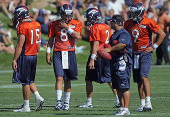 ENGLEWOOD, CO - JULY 28:  (L-R) Quarterbacks Tim Tebow #15, Kyle Orton #8, Adam Weber #2 and Brady Quinn #9 of the Denver Broncos take part in training camp at the Paul D. Bowlen Memorial Broncos Centre at Dove Valley on July 28, 2011 in Englewood, Colora