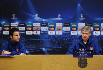 BARCELONA, SPAIN - MARCH 07:  Arsene Wenger (R), Manager of Arsenal sits besides player Cesc Fabregas during a press conference ahead of their UEFA Champions League round of 16 second leg match against Barcelona at the Camp Nou stadium on March 7, 2011 in